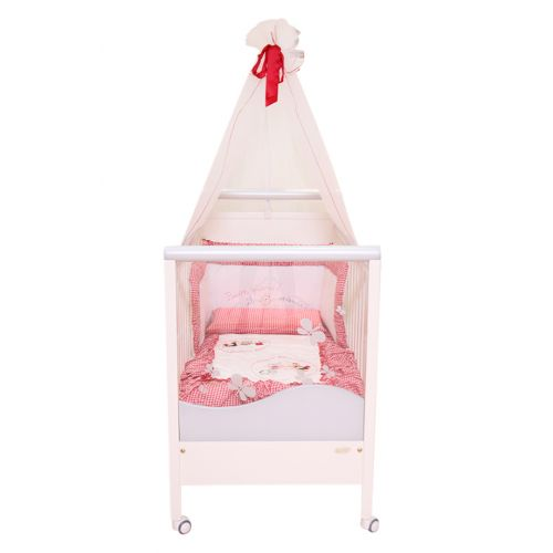 White Crib with Falling Veil, Red Bow and Wheels
